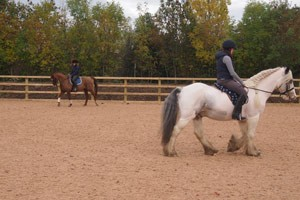 Vet Rosie Owen and equine nursing assistant Becka Brown test out the new arena on their own horses.
