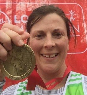 Laura with her medal.