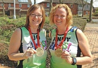 VBD's Jo Woods, left, and Jenny King with their medals for completing the London Marathon.