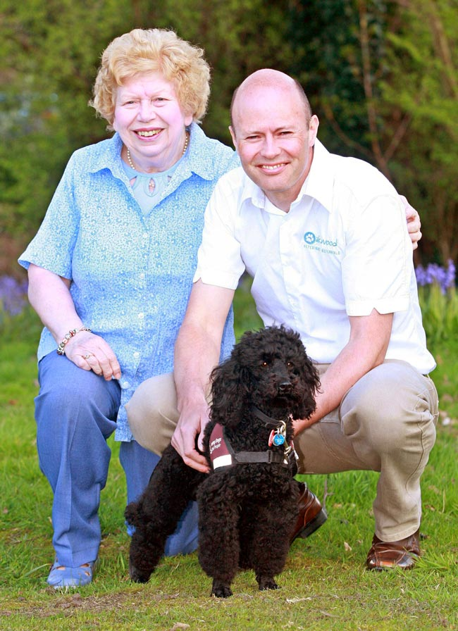 Vet Charlie Sale with Thelma Mannington and her hearing dog Jessie.