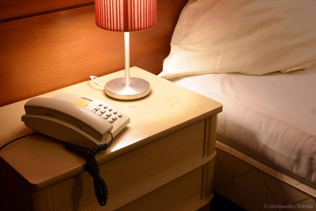 Telephone by bed
