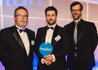 The 2016 Vet of the Year Richard Williams, pictured (centre) at the awards with BVA past-president John Blackwell and host Marcus Brigstocke.