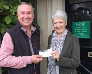 Neil Brimson, equine partner at Garston Vets, presented a cheque for £587.46 to the Hannah's grandmother, June Clothier.