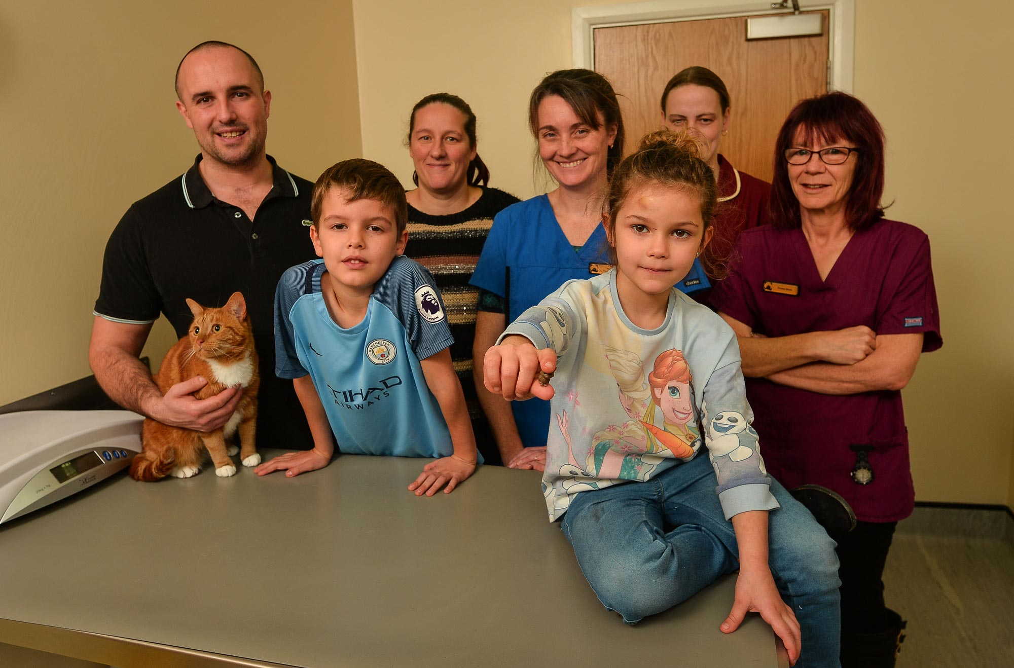 Kitty with her loving family, veterinary surgeon Ann Mee and vet nurses Yvonne Stone and Tammy Harrison.