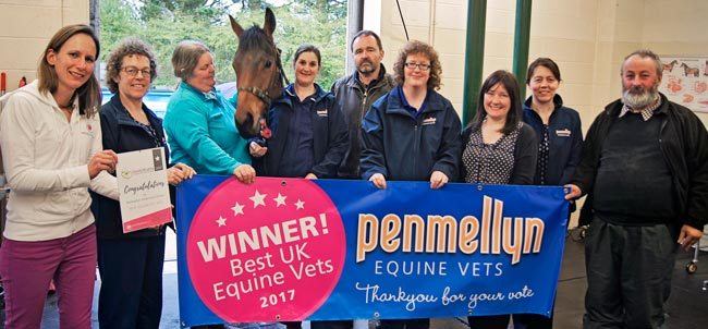 Penmellyn Vets' equine team receives the certificate for Best Equine Vets from Susie Samuel (left).