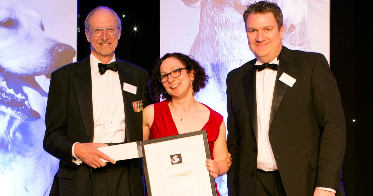 Jenny Stavisky receives the Vet of the Year award from head judge Chris Laurence MBE (left) and Veterinary Times editor Paul Imrie.