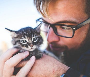 man with kitten
