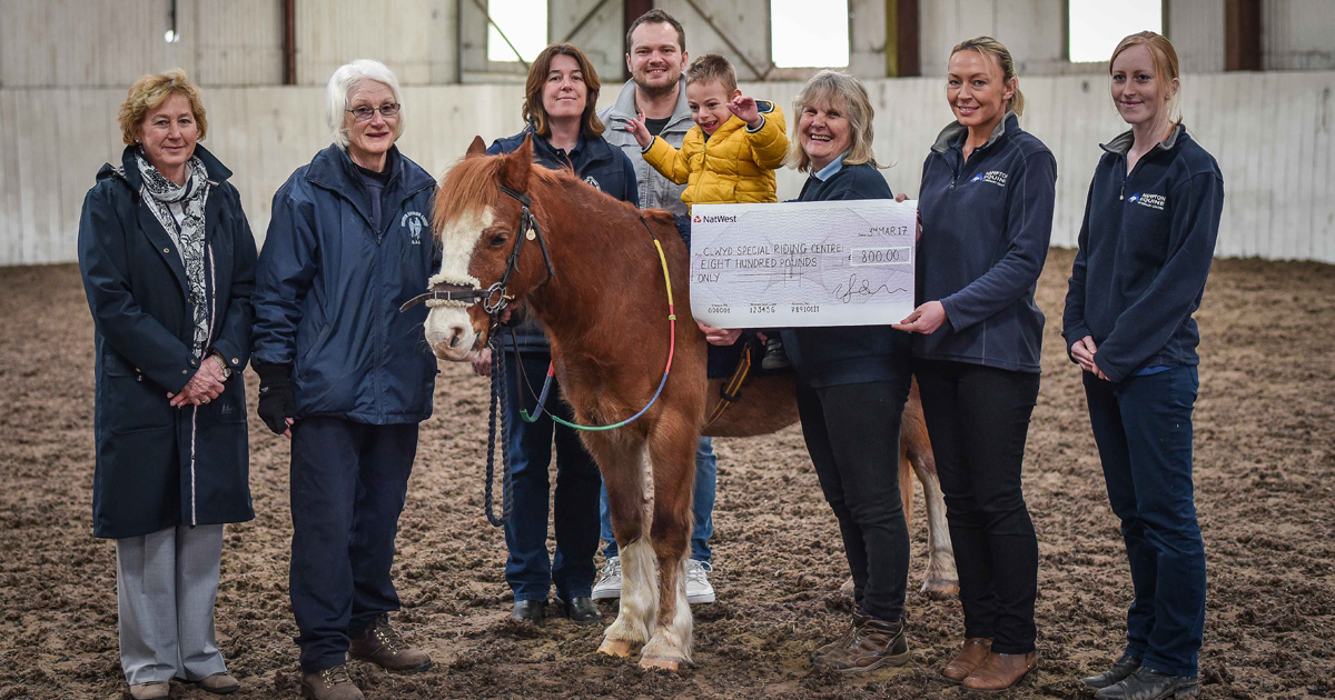 Willows Veterinary Group made an £800 donation to Clwyd Special Riding Centre. From left to right; are CSRC chair of trustees Ann Lambert, volunteer Lynn Bradley, CSRC centre manager Sorrel Taylor, Maks' Dad Jacek, Maks, Lynne Munro and was Kate Sumner and Jenny Watson of Hampton Veterinary Centre.
