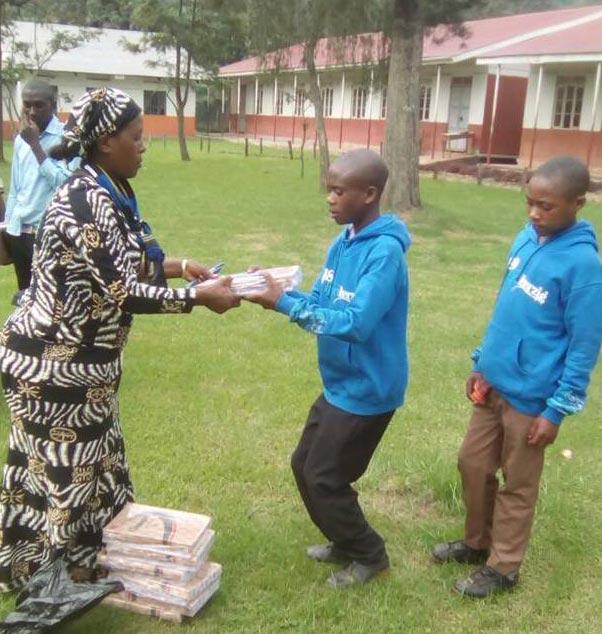Children receiving their new school supplies.
