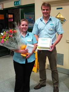 Heather Hobin receives flowers and a cake from Chris Ventner (Vet, Companion Care Vets Harlow).