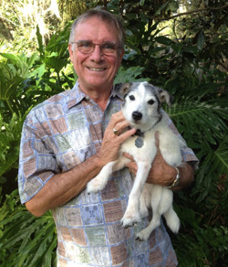 Prof Burrows – pictured here with his dog Buster – is a British national and an emeritus professor at the University of Florida's vet school.