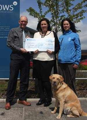 L-R: Peter Renwick gives his practice's cheque to the GDBA's Kerry Hemmings and Carol Warner, pictured with AJ.