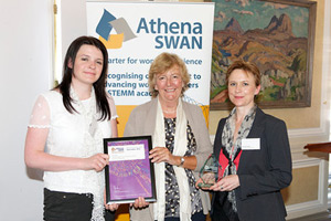 Dick Vet HR manager Catherine Eastwood, Dame Julia Higgins (giving the award) and Anna Meredith