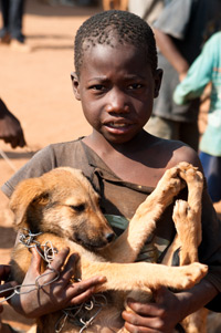 Boy bringing his puppy to receive rabies vaccination.
