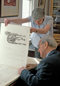 Norman Comben, veterinary advisor to the RCVS Charitable Trust Library's historical collection, and librarian Clare Boulton examine George Stubbs' Anatomy of the Horse (1766).