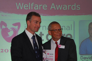 The RSPCA's David Yates recieving his outstanding achievement award from iCatCare's Andy Sparkes