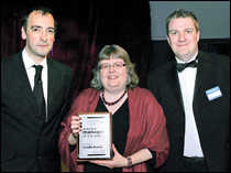 Impressionist Alistair McGowan (L) and Paul Imrie (R) present 2010  Practice  Manager of the Year, Estelle Busby, with her award.