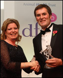 Gil Riley receives his award from Alison Andrew