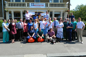 The team at Goddard Veterinary Group showcase the money raised for Cats Protection and Dogs' Trust