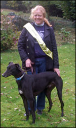 Pamela Sedgwick from the Retired Greyhound Trust with donor Champ