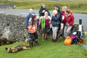 Spirits are high as the team take a break at Ribblehead.