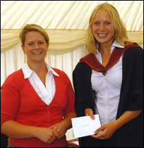 Sarah Harland (R) receives her prize from Heather Metcalfe, regional manager South, Dechra Veterinary Products