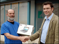 Alan Beatty is presented with his Dell Mini