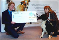 Simon Boulton presents a cheque to Vanessa Rossiter